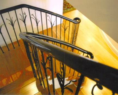 Ebony handrail on blacksmithed ballistrading.jpg